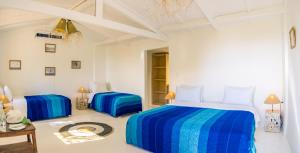 A bed or beds in a room at Dakhla Attitude