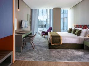 Postel nebo postele na pokoji v ubytování Ibis Styles Dubai Jumeira