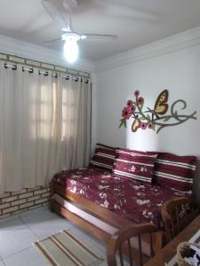 A bed or beds in a room at Apê Namastê