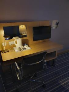 A television and/or entertainment center at Holiday Inn Express Rotherham - North, an IHG hotel