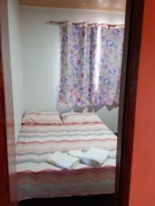 Cama ou camas em um quarto em Quitinete -Tamoios - Cabo Frio