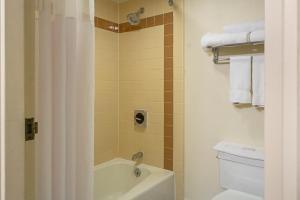 A bathroom at Quality Inn & Suites