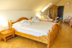 Postel nebo postele na pokoji v ubytování Apartmány u Petry
