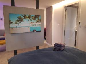A television and/or entertainment center at House By The Beach
