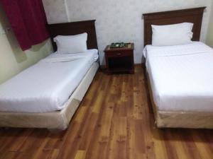 Cama ou camas em um quarto em المقصورة 1 للأجنحة الفندقية