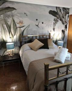 Cama o camas de una habitación en Apartamento Plaza Mayor Trujillo