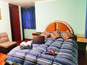 A bed or beds in a room at Vacahouse 2 Eco-Hostel