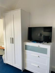 A television and/or entertainment centre at The Grey Walls