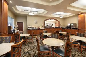 A restaurant or other place to eat at Ramada by Wyndham Olympia