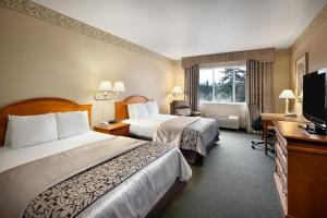 A bed or beds in a room at Ramada by Wyndham Olympia