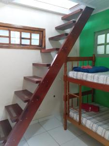 A bunk bed or bunk beds in a room at Pousada Guaruça