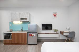 A kitchen or kitchenette at HAMA Boutique Home