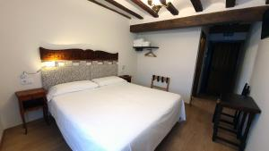 A bed or beds in a room at Posada Ignatius