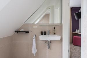 A bathroom at Boutique Hotel Societe