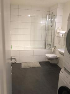 A bathroom at Cocoon 77 Apartments