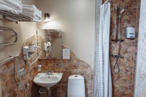 Ванная комната в Отель 3 Гнома