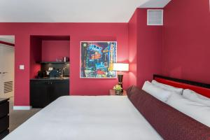 A bed or beds in a room at Opus Hotel