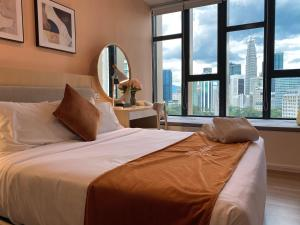 A bed or beds in a room at Ceylonz Suites by MyKey Global