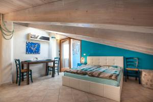 A bed or beds in a room at Studio Azzurro r