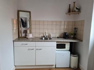 Een keuken of kitchenette bij Evy's place