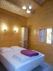 A bed or beds in a room at Gîtes Bon Air