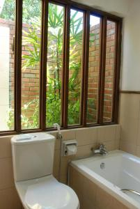 A bathroom at Frangipani Langkawi Resort