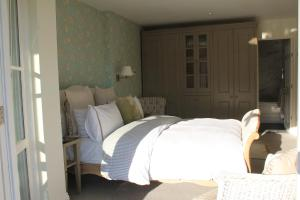 A bed or beds in a room at Compass Rose