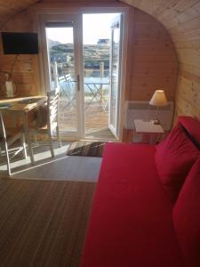 A seating area at Glamping Pod for 4 Pod Beag Na Haun Eriskay