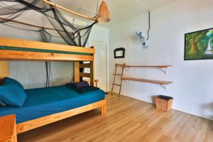 A bunk bed or bunk beds in a room at Bigfin beach resort