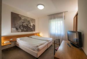 Letto o letti in una camera di Hotel Rendez Vous