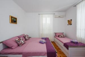 Postel nebo postele na pokoji v ubytování Apartment Ivana