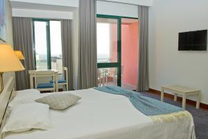 Een bed of bedden in een kamer bij Aparthotel Imperatriz