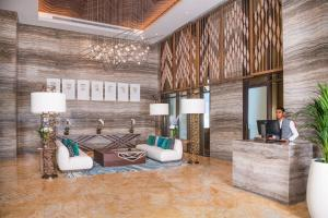 A seating area at Al Jaddaf Rotana Suite Hotel