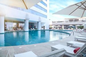 The swimming pool at or close to Al Jaddaf Rotana Suite Hotel