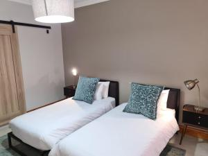A bed or beds in a room at Uitsig Boutique Hotel