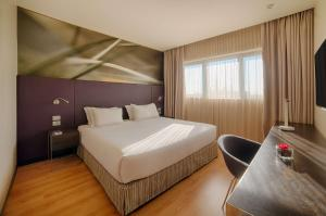 A bed or beds in a room at NH Orio Al Serio