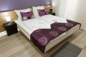 A bed or beds in a room at B&B Nataly 2