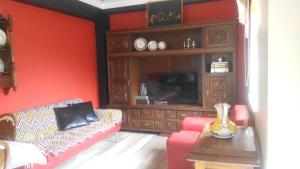 A television and/or entertainment center at House with 2 bedrooms in Manteigas with wonderful mountain view and balcony 7 km from the slopes