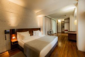 Posteľ alebo postele v izbe v ubytovaní Palla Boutique Hotel