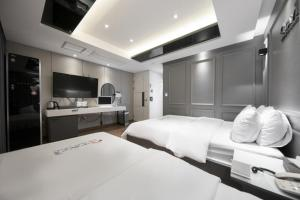 A television and/or entertainment center at ACC Stay Hotel Gwangju
