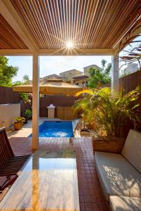 The swimming pool at or near Dar 66 Townhouses Walk to Beach