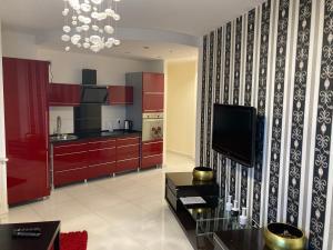 Telewizja i/lub zestaw kina domowego w obiekcie JAB Apartments Bandurskiego Business & Family