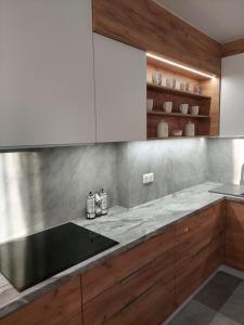 Кухня или мини-кухня в Apartments Maria