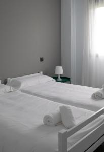 A bed or beds in a room at ALOJAMIENTO RURAL SUSEiA