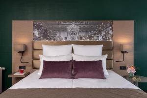 A bed or beds in a room at Leonardo Royal Hotel Baden- Baden