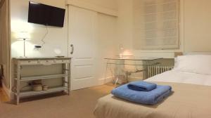 Cama o camas de una habitación en ESPRONCEDA