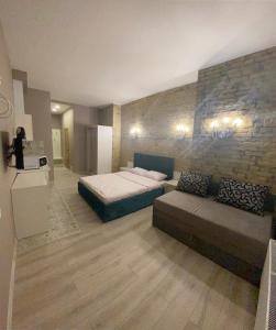 Ein Bett oder Betten in einem Zimmer der Unterkunft Heart Kiev Apart-Hotel