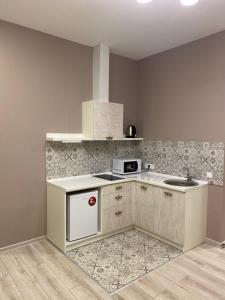 Küche/Küchenzeile in der Unterkunft Heart Kiev Apart-Hotel