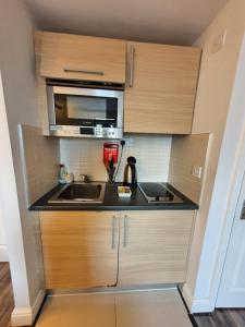 A kitchen or kitchenette at W6 Hotel