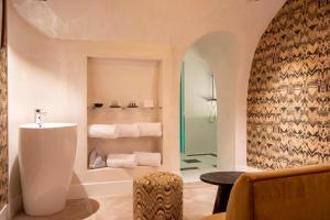 A seating area at Philéas Lazare & Spa